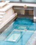 """""""The design of the mansion's swimming pool is extremely smart. The basement kitchen can be entered through this."""""""