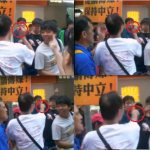 "A member of ""Caring Hong Kong Power"" flashed a pair of scissor in front of the leader of anti-National Education, Joshua Wong (in black shirt). Source"