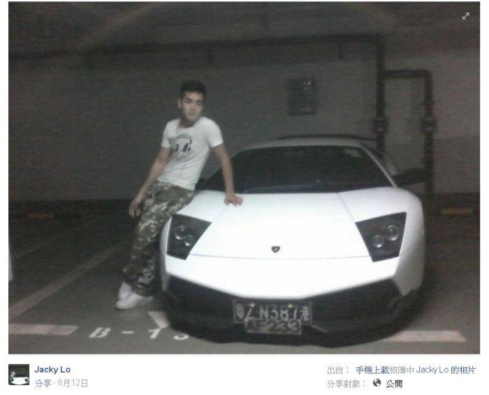 Photo of Lo Sitting on a Lamborghini